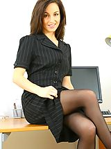 Sexy Mel slowly teases her way out of her secretary outfit in the office