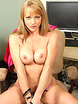 Secretary Pics: Busty brunette milf Shayla Laveaux shows off her needy cougar pussy in the office
