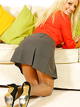 Busty blonde Elena in a smart secretary outfit with thong and pantyhose.