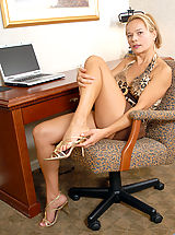 Busty Anilos Viktoria caresses her clitoris on top of her desk
