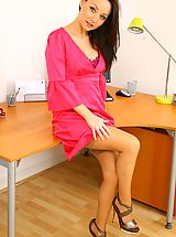 Secretary Pics: Delightful brunette Carla in a pretty pink dress and pink lingerie.