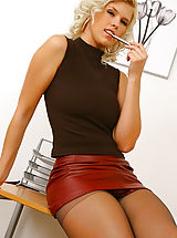 Saucy secretary Amy G loves to make a good impression in her red leather miniskirt