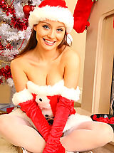 Lovely Carla seductively removes sexy Santa Claus outfit.
