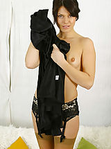 Abbi in black evening dress with tan stockings