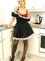 Only Tease Pics: Melanie in a sexy French maid's outfit with stockings and red bra and panties.