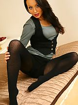 Carla looking stunning in a sexy black mini skirt with black pantyhose and boots.
