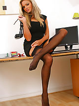 Only Tease Pics: Naughty Jennifer lets her black minidress hit the floor as she strips in her office