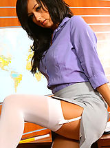 Beautiful brunette secretary Laura A strips from her cute grey suit and purple shirt to give us a glimpse of her sexy white lingerie