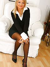 Blonde beauty Liana Lace relaxes on her sofa in nothing but holdup stockings.
