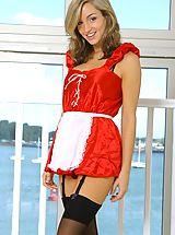 Saucy French maid Melanie dressed to thrill with sexy french knickers and dark stockings.