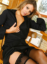 Secretary Pics: Gorgeous brunette Chrystal Lee removes her smart black outfit and reveals delightful lingerie.