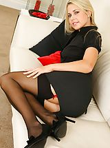 Naughty Office, Renata looks gorgeous as she slowly removes her sexy secretary outfit revealing her red and black stockings and suspenders