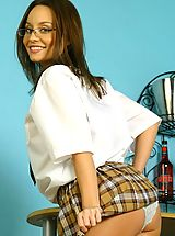 Carla in sexy college uniform with tartan skirt.