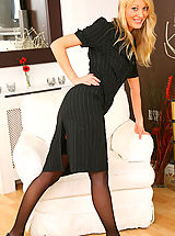 Lovely Maria S can't wait to show us what beauty lies beneath her smart minidress
