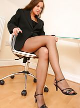 Michaela looks amazing as she seductively teases her way out of her gorgeous pinstripe jacket and mini dress to reveal her sexy brown pantyhose