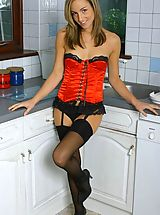 mini skirts, Melanie in red satin basque with black stockings