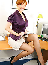 Long Legs, Saucy secretary in smart office outfit with light lingerie and stockings.