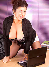 Playmates Pics: Sultry milf Secretary strips off her office attire and spreads her hot mature snatch