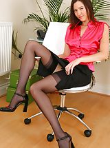 Secretary Pics: Carole looking stunning in satin top and tight skirt. Non Nude