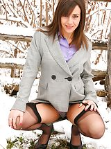 Emma H looking stunning in the snow in her sexy secretary outfit.