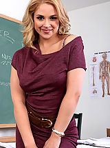Busty hot blonde teacher is wet, horny and ready to suck and fuck her big cocked student on her desk.