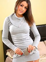 Stocking High Heels, Stunning Bryoni-Kate relaxes on her bed in a sexy tight grey top with black stockings.