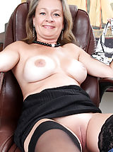 Upskirts, Lovely busty mom strips in front of her laptop