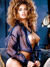 Suze Randall Pics: Now at pure porn stardom, she shines in electric blue and will shock your jock strap right off.