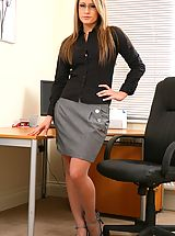 Open Legs, Candice wearing a black blouse with a grey skirt and grey stockings.