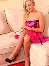 Gorgeous Paige D slips out of her pink satin evening dress and teases in her sheer panties and stockings.