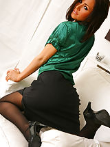 Classy Legs, Sexy brunette secretary Gemma Massey relaxes on her sofa in nothing but gorgeous opaque pantyhose Non Nude