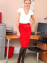 Stunning brunette does a sexy striptease in her office.