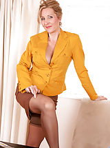 Secretary Pics: Horny Anilos milf executive looks great as she pleasures her hairy pussy in the office
