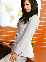 Sexy Secretary, Beautiful brunette secretary Laura A strips from her cute grey suit and purple shirt to give us a glimpse of her sexy white lingerie Non Nude