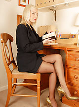 Not your usual business brain, however Clair Lou has some high interest property on her legs...some very special bow heel Harmony Point fully fashioned nylons. So when she's down to bare basics (nylons, girdle and heels!) you can be sure to shed some of y