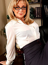 Sexy Secretary, Busty blonde teacher seduces her big cocked student on her desk for hot sex.