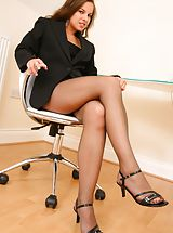 Secretaries, Michaela looks amazing as she seductively teases her way out of her gorgeous pinstripe jacket and mini dress to reveal her sexy brown pantyhose Non Nude