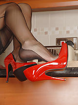 Undressed Housewife in Lingerie We catch Saffy in the kitchen, yet not working for long! Play is more fun, and the Essex chick in red stiletto s is able to play! Quickly showing all this trim curvy babe is a delight in bullet boobie harness, vintage power