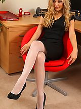 Beth looking smart in this sophisticated black dress and white hosiery.