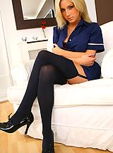 Tindra looks amazing as she teases her way out of her sexy nurse�s uniform
