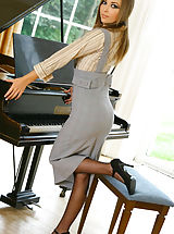 Stunning Loora strips out of her secretary outfit by her piano revealing her sexy purple lingerie and stockings Non Nude