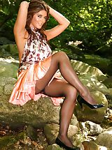 Pantyhose Pics: Gorgeous brunette Kelly M dressed in a patterened top and orange miniskirt.