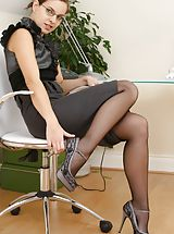 Black High Heels, Stunning brunette slips out of the skirt and satin blouse. Non Nude