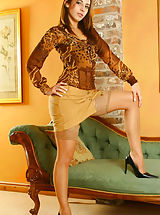 Sultry Emma wearing miniskirt and tan stockings