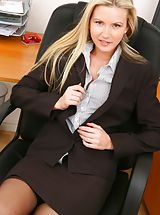 Breathtaking blonde secretary in smart black skirt suit. Non Nude