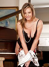 Elegant milf Louise Pearce undressed during the piano.