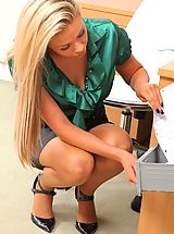 Hot Secretary, Beautiful blonde secretary teases her way out of her silk blouse and tight pencil skirt.