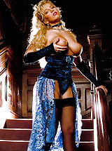 Suze Randall Pics: Sandra is scorching in this set showing off her extra large mammaries and lioness long hair, grrrr!