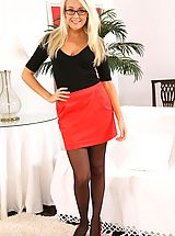 Secretary Pics: Lucy Anne wearing a tight black top with a red miniskirt.
