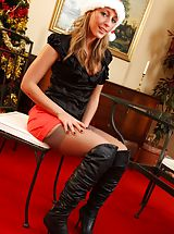Darcy looks a real treat in her knee high boots and red miniskirt.